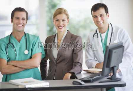 portrait of doctors and businesswoman at