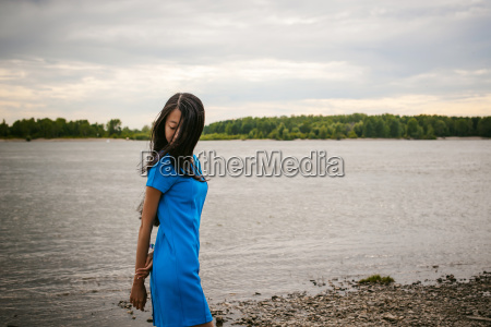 young attractive asian woman dressed in