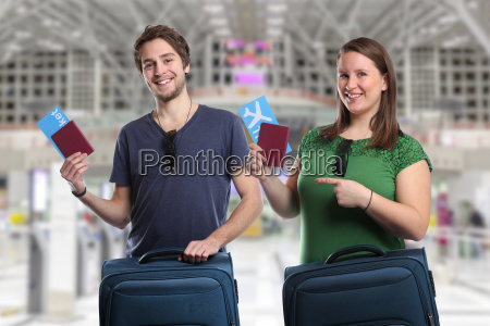 young people traveling with suitcase travel