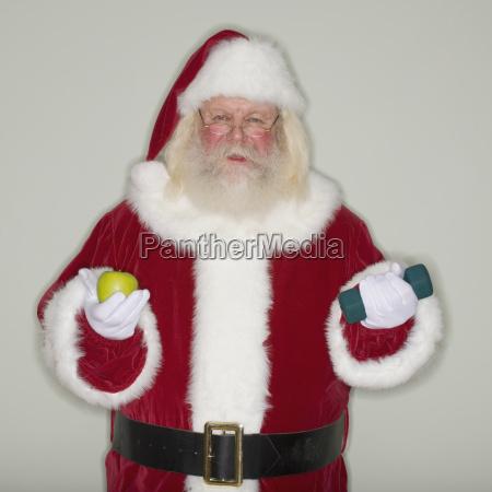 weihnachtsmann mit apfel und hantel