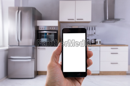 persons hand holding mobile phone