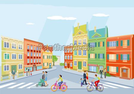kleine stadt mit fussgaenger und radfahren