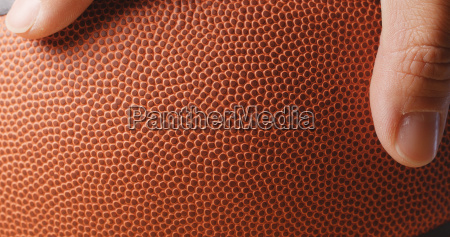 man hand holding basketball