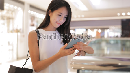 asian woman using mobile phone in