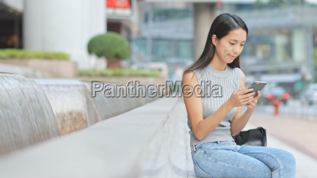 young woman looking at cellphone in