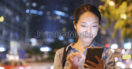 woman using cellphone with the background