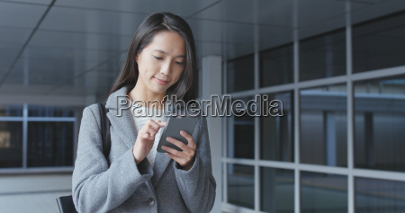 asian business woman using mobile phone