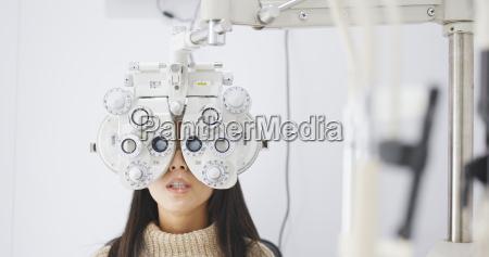 asian woman doing eye test in