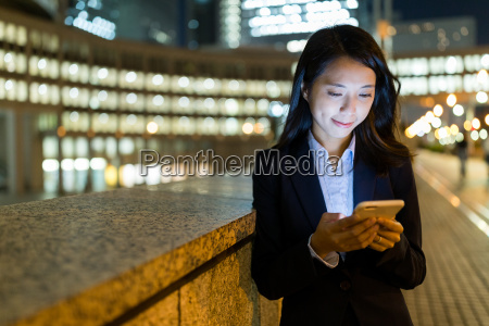 businesswoman use of mobile phone in