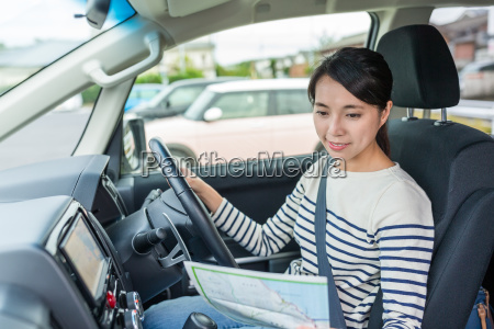 asian woman using city map and