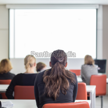 audience in the lecture hall listening