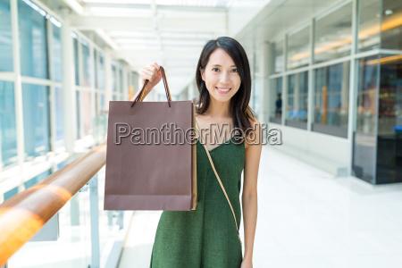 asian young woman holding shopping bag