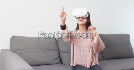 asian woman play with vr device