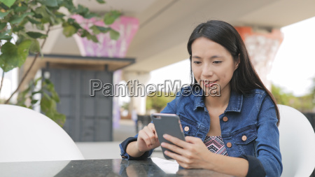 young woman using mobile phone at