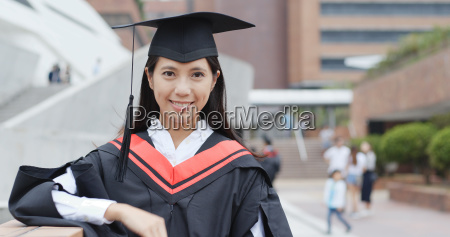 asian woman get graduation in university