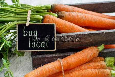 fresh raw carrots with leaves in