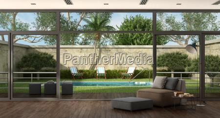 wohnzimmer einer villa mit pool im