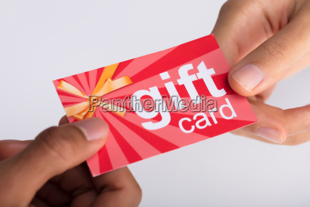 two businesspeople holding gift card