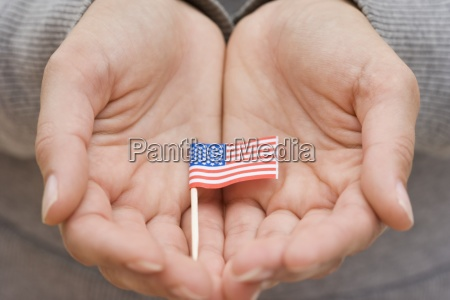 hands holding small us flag