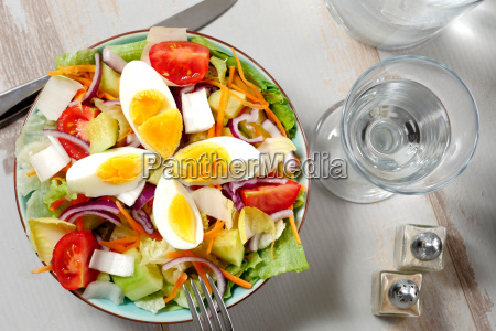 vegetable salad on white wooden table