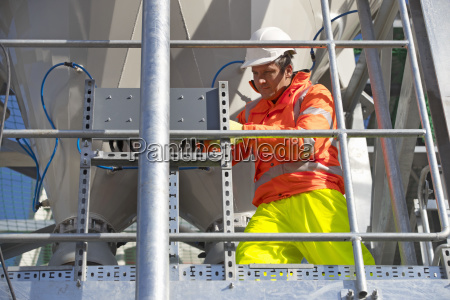 engineer wearing hi viz protective clothing