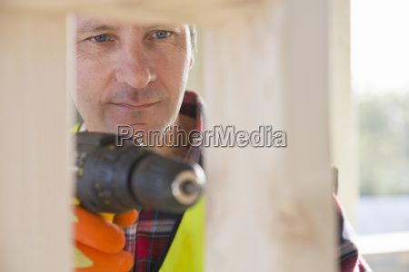 close up of carpenter using power