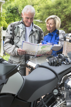 senior couple looking at map next