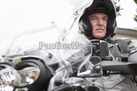 confident senior man wearing helmet on
