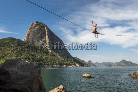 man posing on high line in