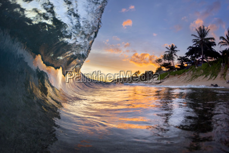 view inside breaking wave at dawn