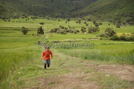 toddler running on dirt road in