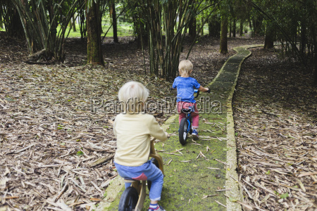 two little boys with bikes in