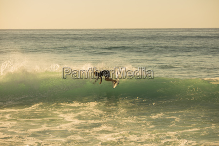 surfer doing a cutback on a