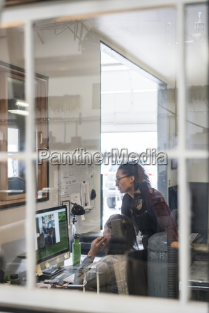two women looking at computer screen
