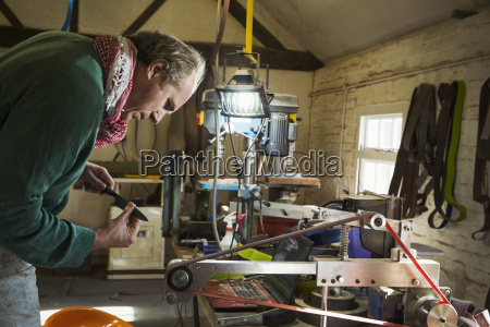 a craftsman looking at a small