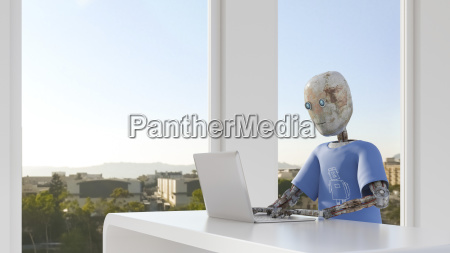 robot working in office using laptop