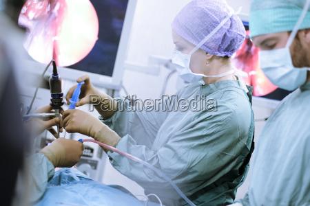 neurosurgeons in scrubs during an operation