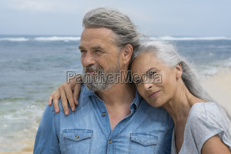handsome senior couple embracing at the