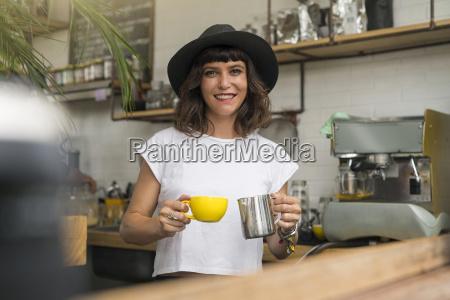 portrait of woman with black hat
