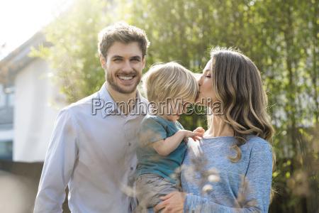 happy family in garden in front