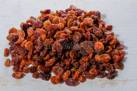 pile of organic raisins on white