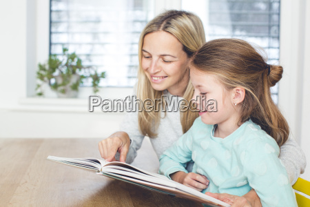 mother, is, reading, a, book, with - 24179648