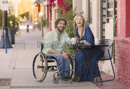woman with man in wheelchair at