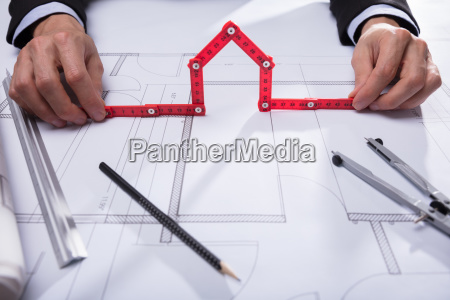 architect holding house made with red