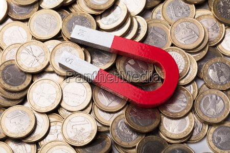 red horseshoe magnet on euro coins