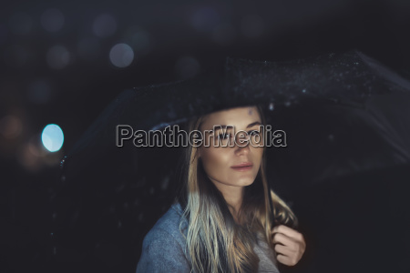 beautiful woman at rainy night