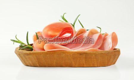 thin slices of ham with rosemary