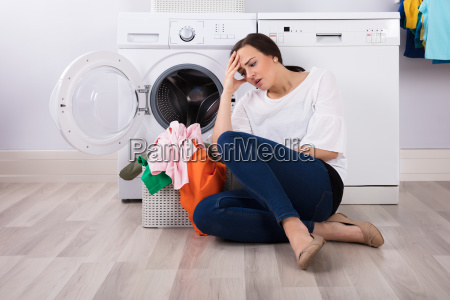 exhausted woman sitting with basket full