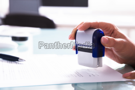 close up of a businessperson stamping