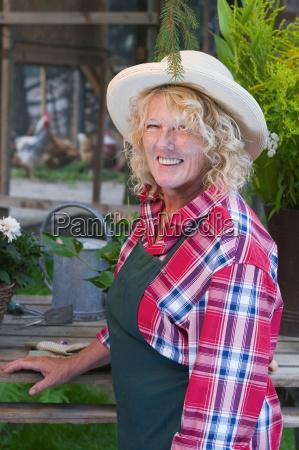 smiling female gardener side view